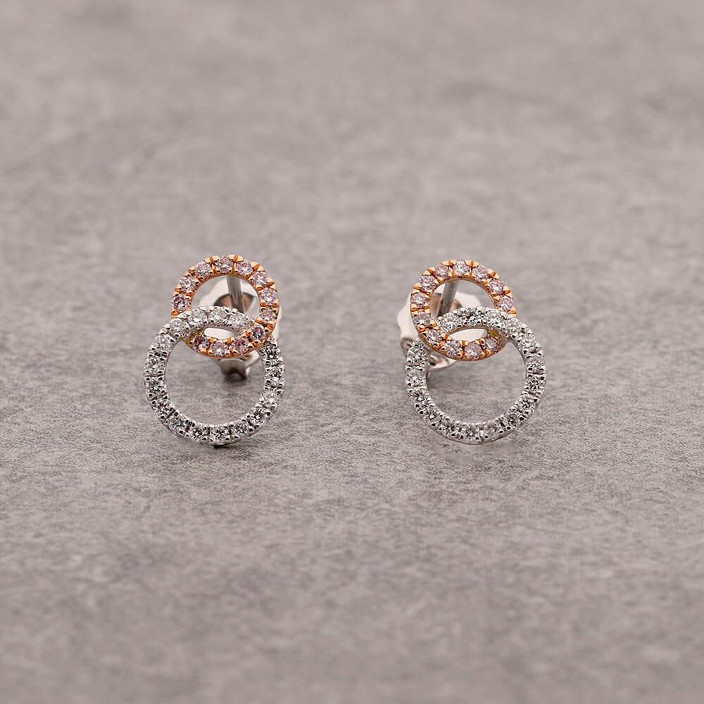 Pink diamond circle earrings.